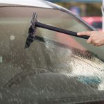 washing insects and black-flies from a car windscreen